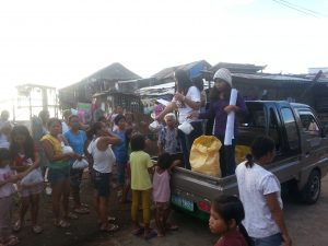 Giving out the relief packages