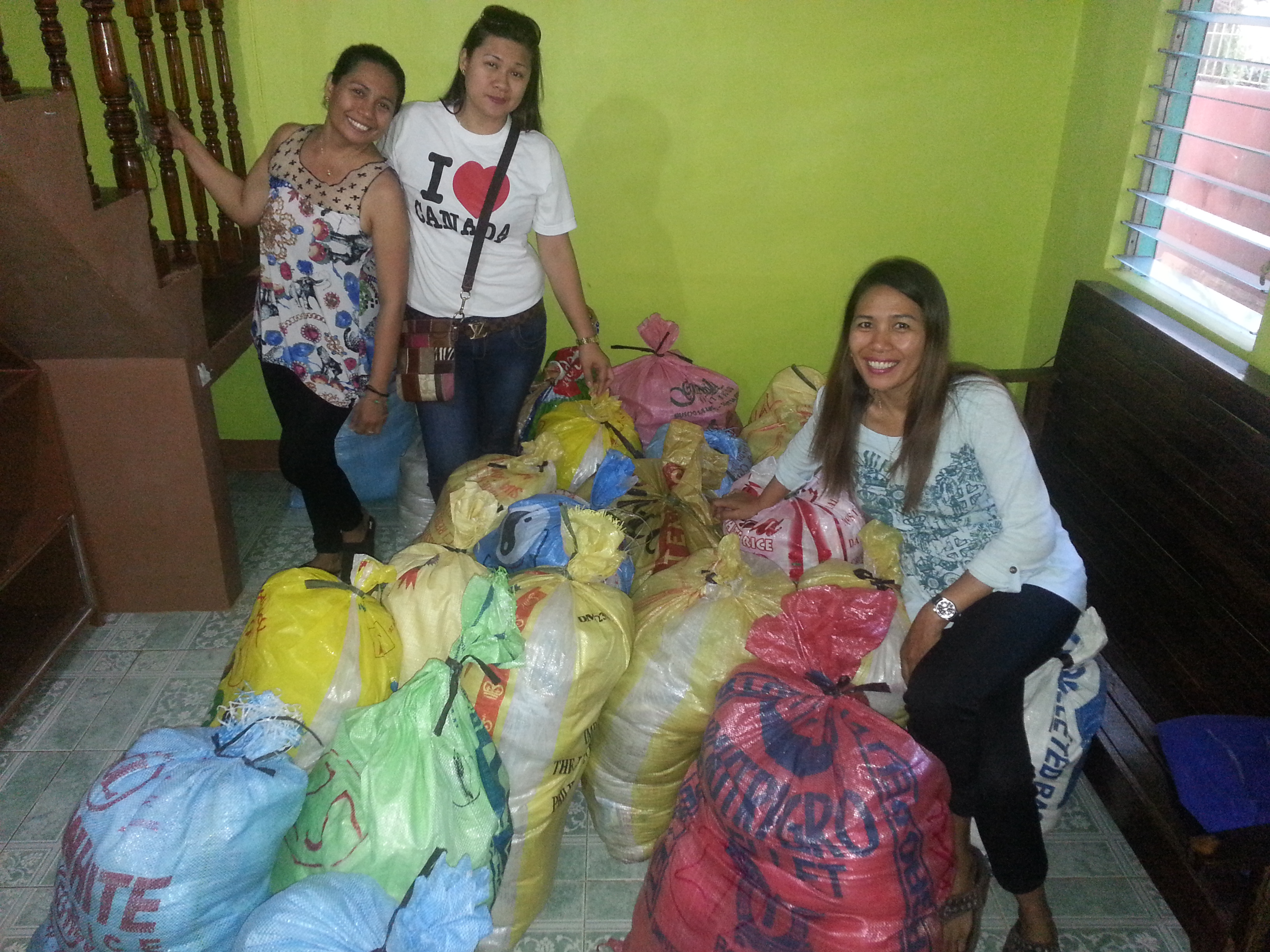 Typhoon Yolanda - A photo of Leonor and her sisters getting ready to deliver the relief goods